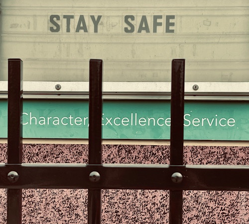 "Sign that says ""Stay Safe"" and underneath, ""Character Excellence Service"""