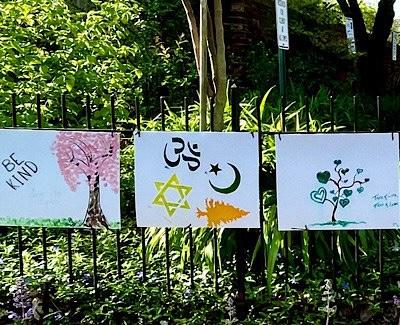 """Handmade signs; one says """"be kind."""""""