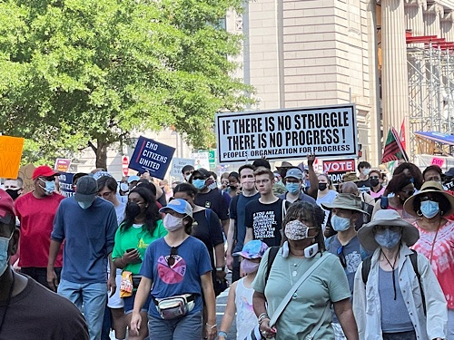 """Demonstration sign reads:  """"if there is no struggle , there is no progress . People's Organization for Progress, End Citizen United"""